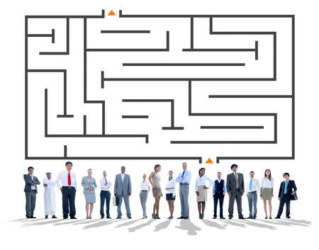 People standing below a maze Stock Photo