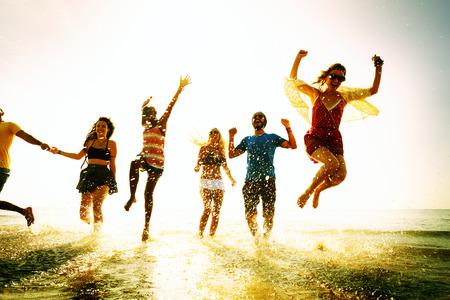 enjoying: Diverse Beach Summer Friends Fun Running Concept