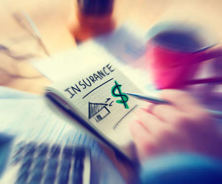 home insurance: Businessman Working Finance Home Insurance Concept