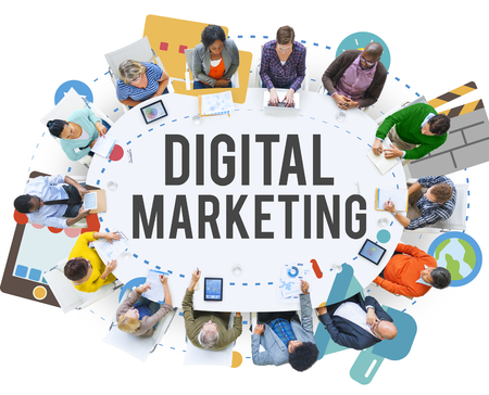 The word DIGITAL MARKETING with people in a meeting Stock Photo
