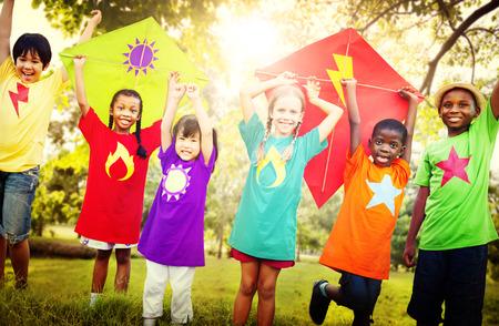 kite flying: Children Flying Kite Playful Friendship Concept Stock Photo