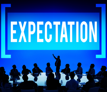 The word EXPECTATION with people in a conference