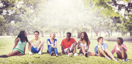 smiling teenagers: Students Friendship Team Relaxation Holiday Concept Stock Photo