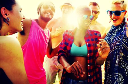 sunny season: Diverse Group People Beach Party Dancing Concept Stock Photo