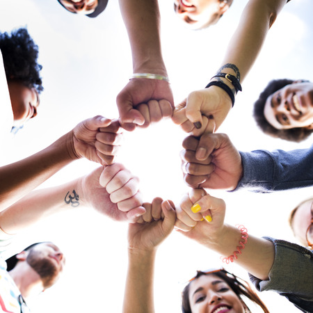 friendship circle: Friends Friendship Fist Bump Togetherness Concept Stock Photo