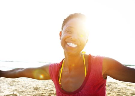 african woman: African Woman Beach Happiness Freedom Concept Stock Photo