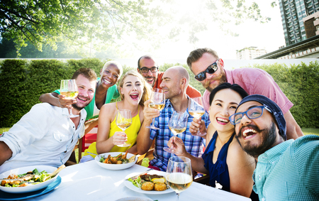 Friends Dining Outdoors Party Cheerful Concept Foto de archivo