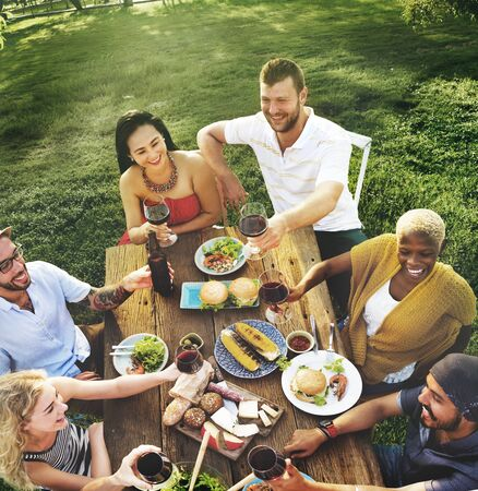 smiling: Diverse People Luncheon Food Garden Concept Stock Photo