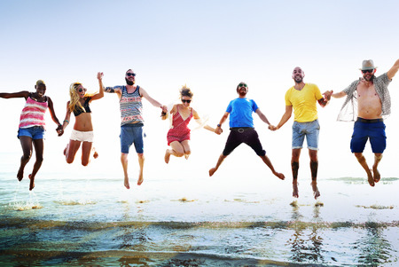 fun: Diverse Beach Summer Friends Fun Jump Shot Concept Stock Photo