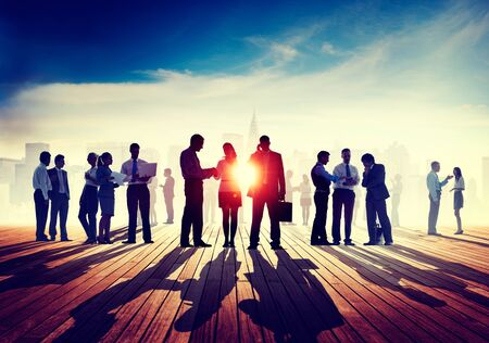 back lit: Back Lit Business People Discussion Skyline Concept Stock Photo