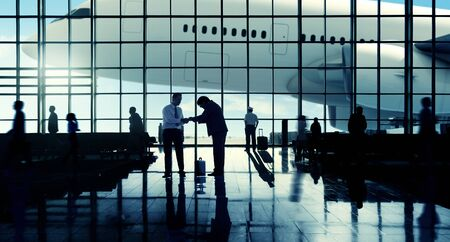 business travel: Business Travel Handshake Communter Terminal Airport Concept Stock Photo