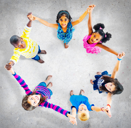 people holding hands: Children Kids Cheerful Unity Diversity Concept