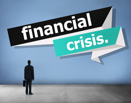The word Financial crisis with a businessman Stock Photo
