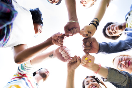 teamwork together: Friends Friendship Fist Bump Togetherness Concept Stock Photo