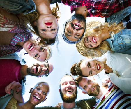 huddle: Friends Huddle Join Holiday Party Group Concept Stock Photo
