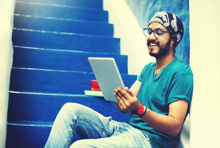 sikh: Sikh Guy Browsing Tablet Stair Case Concept Stock Photo