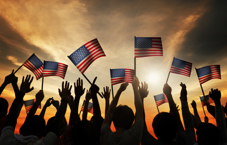 usa flags: Group of People Waving Armenian Flags in Back Lit Stock Photo