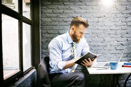 book concept: Business Man Reading Notes Book Concept