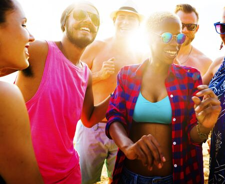 party people: Diverse Group People Beach Party Dancing Concept Stock Photo