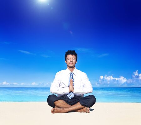 man office: Businessman meditating on the beach Relaxation Concept