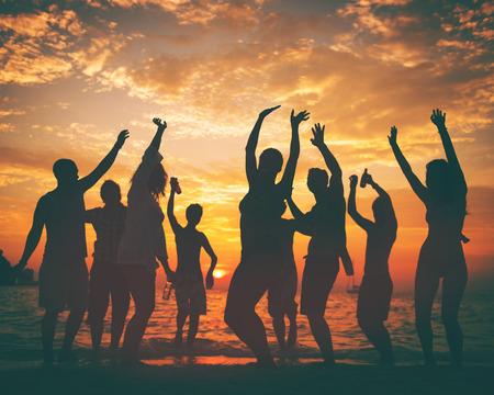 Young Adult Summer Beach Party Dancing Concept Foto de archivo