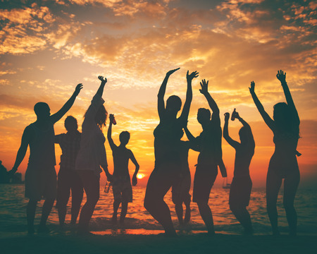 guy on beach: Young Adult Summer Beach Party Dancing Concept Stock Photo