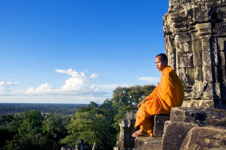 angkor wat: Contemplating Monk Angkor Wat Siem Reap Cambodia Stock Photo