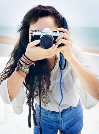 stylish woman: Pretty Photographer Woman Beach Vacation Lifestyle Concept