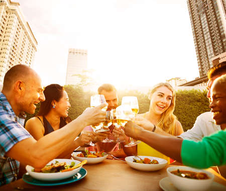 asian adult: Friends Dining Outdoors Party Cheerful Toast Concept