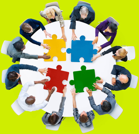 puzzle business: Business People Jigsaw Puzzle Collaboration Team Concept