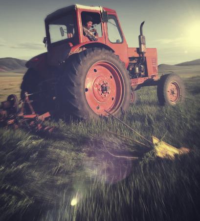 mongolian: Mongolian Farmer Driving Tractor Field Agicultural Concept