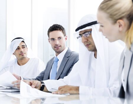 business relationship: International Global Business Discussion Partnership Concept Stock Photo