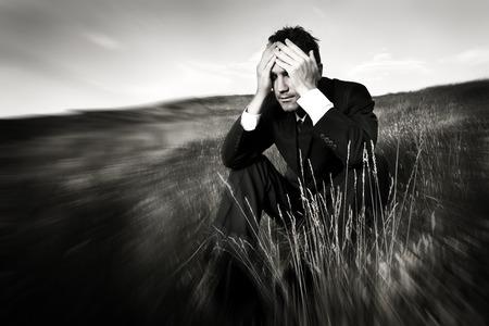 Lonely businessman depressed about life Stress Concept Foto de archivo