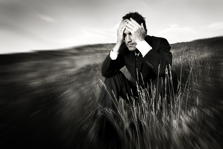 economic depression: Lonely businessman depressed about life Stress Concept Stock Photo
