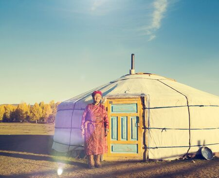 independent mongolia: Mongolian Lady Standing Tent Scenic View Tranquil Concept