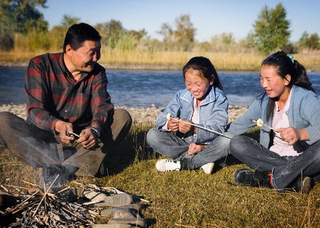 independent mongolia: Mongolian Family Enjoy Camping River Leisure Concept
