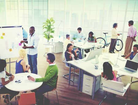 office presentation: Group of Business People in the Office Stock Photo