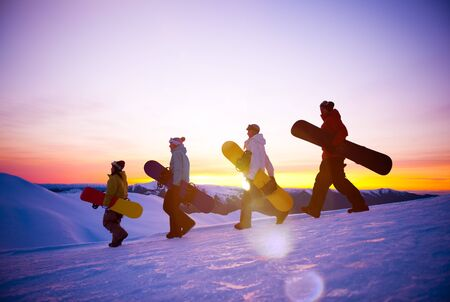 snow landscape: People on their way to snow boarding Concept Stock Photo