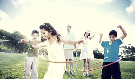 time: Family Bonding Park Relaxing Exercise Concept Stock Photo