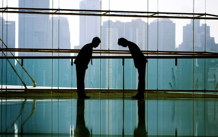 japanese culture: Business People Bowing Japanese Culture Partnership Concept