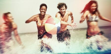 carefree: Friends Vacation Beach Carefree Relax Concept Stock Photo