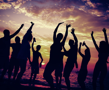 student travel: Young Adult Summer Beach Party Dancing Concept Stock Photo