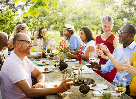 dinner party: Friends Outdoors Nature Picnic Chilling Out Unity Concept Stock Photo