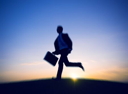 RUSH HOUR: Businessman Running Rush Hour Concept