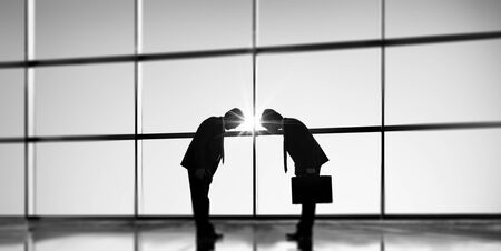 bowing: Businessmen Bowing Corporate Greeting Communication Concept Stock Photo