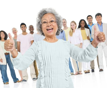 elderly adults: Senior Adult Feel Glad Standing Out Crowd Concept Stock Photo