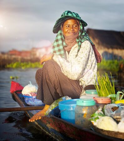cambodian: Local Cambodian Seller Floating Market Siem Reap Concept Stock Photo