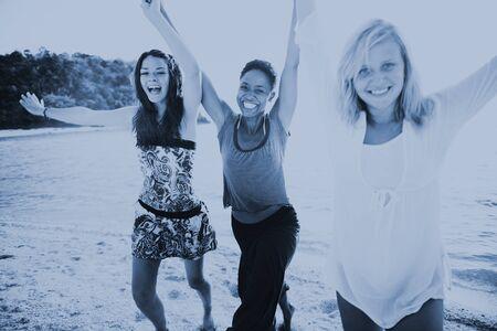 a power: Women Fun Beach Girls Power Celebration Concept Stock Photo