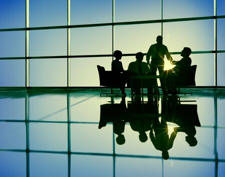 human silhouette: Business Team Discussion Meeting Communication Concept Stock Photo