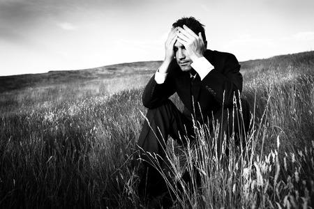 Lonely businessman depressed about life Stress Concept Standard-Bild